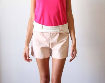 Shorts with thin stripes and Tangerine color cuts