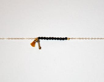 Gold-plated bracelet, micro black Onyx and brown Sapphire beads, vermeil vintage tube, yellow tassel