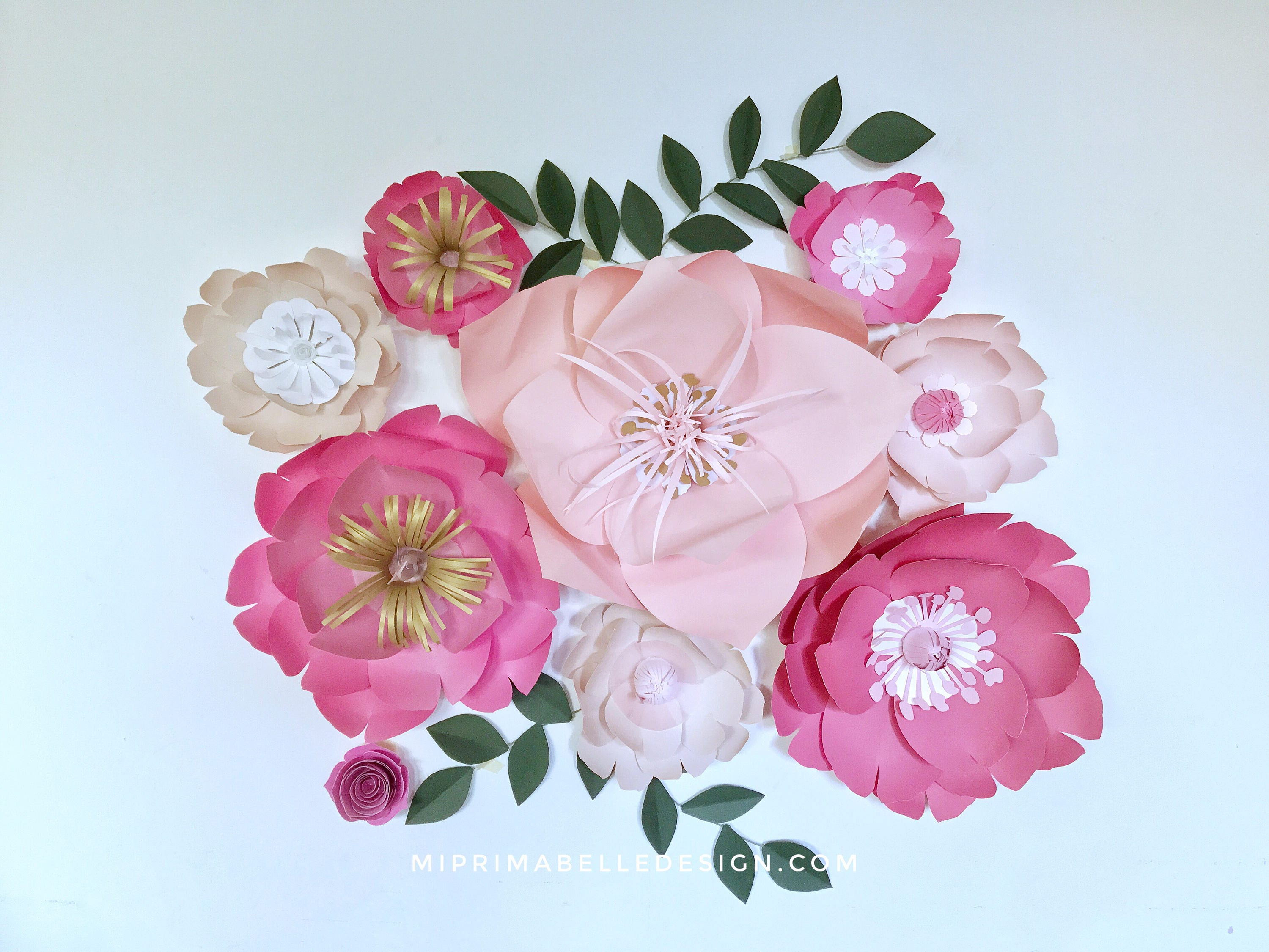 Paper flowers wall decor for a baby girl nursery room wedding