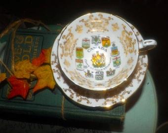 Vintage (1960s) Paragon hand-decorated Canadian Coat of Arms | Provincial Emblems tea set (footed cup + saucer). Fleur de lys, maple leaves