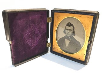 antique ambrotype photo in thermoplastic case