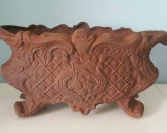 Lovely rusty cast iron jardiniere!