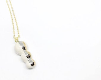 Gold and platinum ceramic pendant from the caterpillars collection