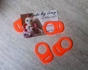 Orange silicone pacifier adapter