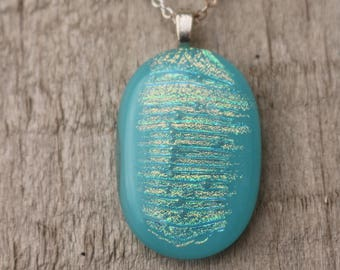 Pendant. Aqua blue/green fused glass with dichroic added for a special sparkle and shimmer.