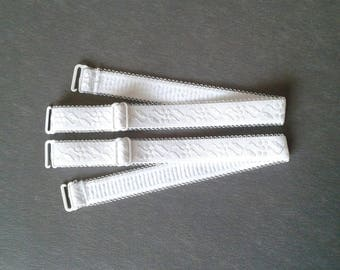 2 removable white elastic straps with adjustment system