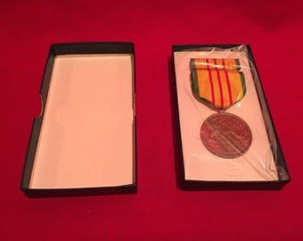 U.S Military Vietnam War Service Medal 1969 dated in Box