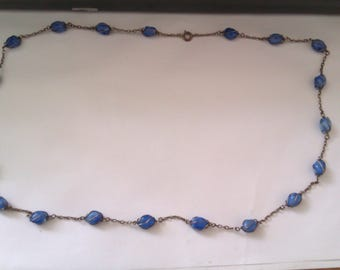 silver coloured wire wrapped blue glass necklace