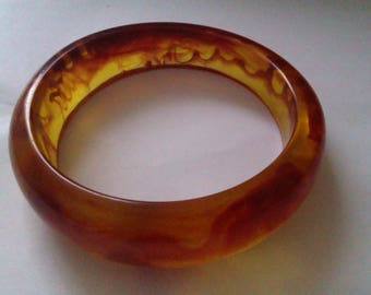 swirl effect amber coloured hard plastic bangle