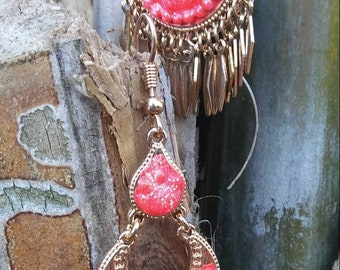 Gold chandelier earrings with coral detail