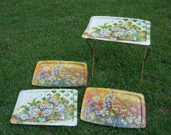 Four LaVada Trays Tops one set of legs.  Daisies, flowers
