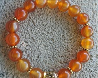 Énergétisé carnelian bracelet orange, Golden zen Buddha
