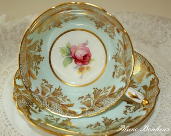 Paragon (double warrant): Light blue tea cup and saucer with pink rose