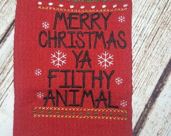 Christmas Dish towel.  Saying inspired from Home Alone movie.  Merry Christmas filthy animal