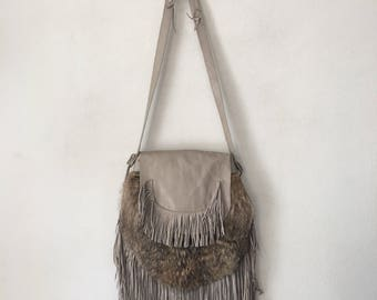 Fringe bag from real raccoon fur&leather with fashionable leather fringe new collection designer handmade women's gray bag has size-medium.