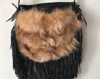 Polar fox hand made fur bag .