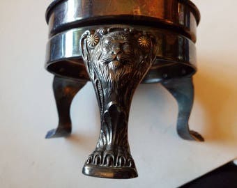 3 legged lion design stand silverplate?