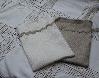 Set of two wash cloths in very fine honeycomb and linen zig zag stripe linen.
