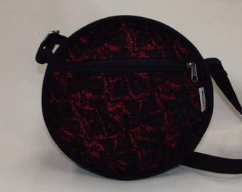 a purse round shoulder black and Red lace fabric