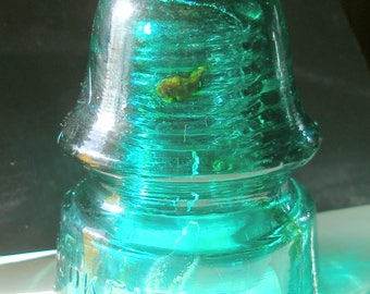 Beautiful BROOKFIELD Glass Insulator with AMBER WHALE