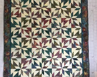 Lap quilt measures 54 x 67 inches