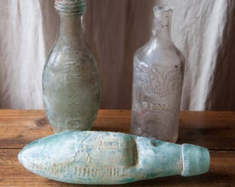 Set of 3 old antique glass bottles