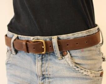 Brown leather belt. Brown leather belt. Leather belt; leather belt.