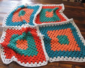 granny square baby blanket, blue and orange