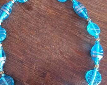 two blue necklaces crew neck