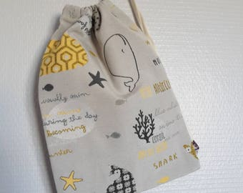 Bag in blanket patterned whale and fish in grey and mustard yellow