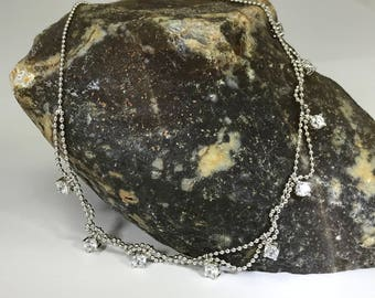 A Beautiful Sterling Silver and Cubic Zirconia Nine Stone Necklace