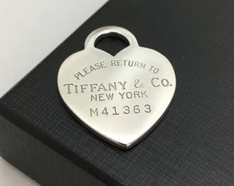 Return to Tiffany & Co New York Silver Charm Pendant