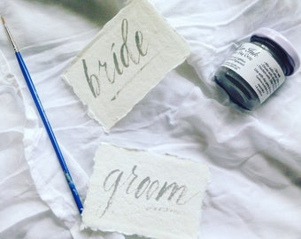 Custom modern brush calligraphy on handmade ethical cotton rag paper for weddings, party supplies - place cards, escort cards