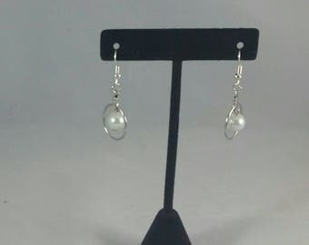 white pearl earrings in hoops