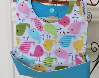 Kahelelani Water-Resistant Fabric Feeding Bib With A Snap Pocket