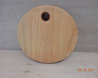 Small round solid cherry cutting board