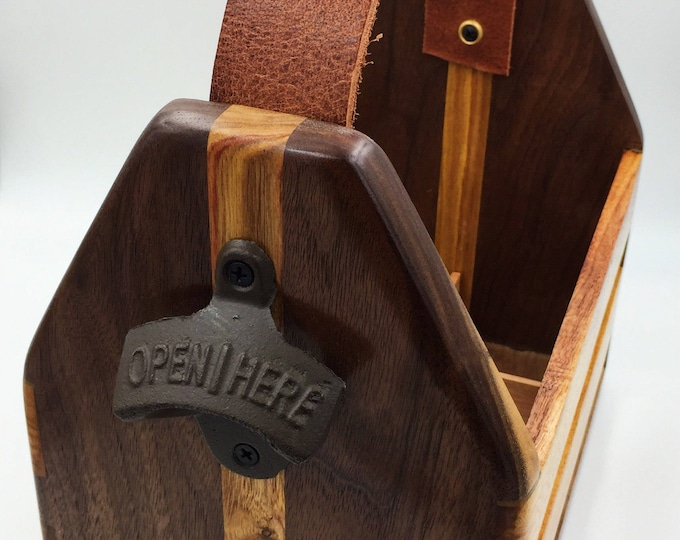 6 pack beer caddy. Walnut and canary wood, with leather handle. Bottle opener built in! Dovetail joints.