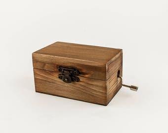 Vintage wooden music box. Handcranked music box movement