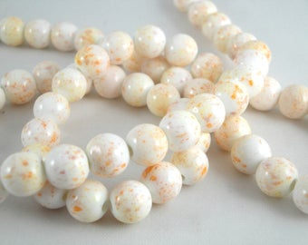 10 ceramic beads 8 mm (PC38): porcelain, white/orange