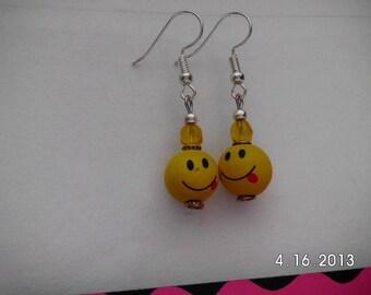 Yellow face earrings.