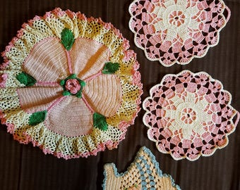Vintage pink crocheted doilies and unique hanging basket