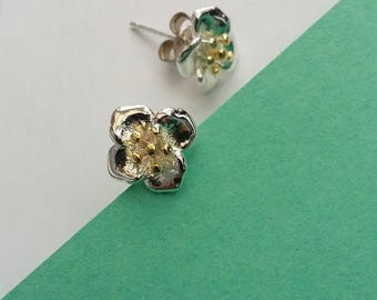 Detailed flower stud earrings made from 925 Sterling silver