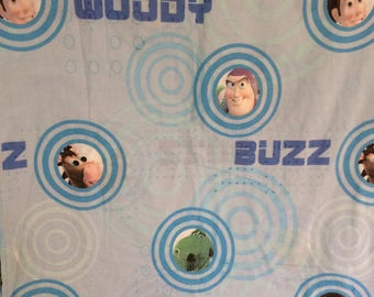 Toy Story, twin flat sheet, blue color, Buzz, Woody, Rex and Bullseye, vintage, preowned, good condition