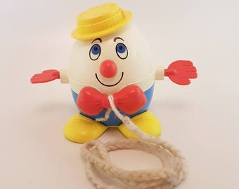 Baby Pull Toy | Fisher Price, Vintage, Rolling, Humpty Dumpty, Waving Hands, white, red, blue, yellow, vintage pull toy