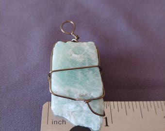 Blue gemstone wire wrapped pendant