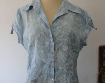 Vintage sky blue linen blouse has white flowers