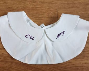 Initial detachable Peter Pan collar. Obscene.