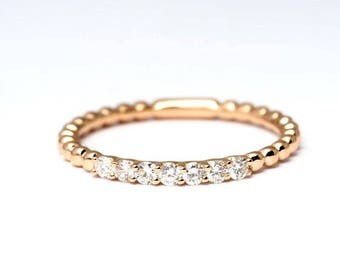 19.2k rose Gold ring with 7 Diamonds