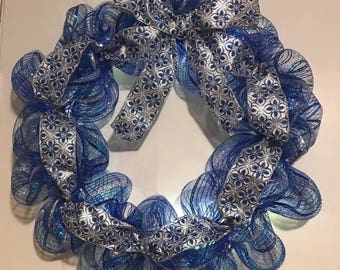 Blue and silver lighted holiday Christmas wreath