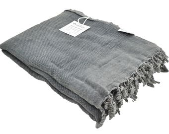 stonewashed turkish throw blanket in charcoal grey faded black perfect as a beach blanket